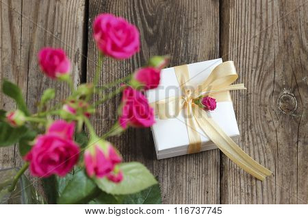 Pink Roses In Glass And Gift Box