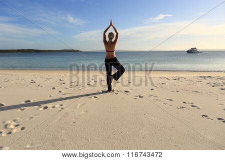 Woman Balancing On One Leg Yoga Pose