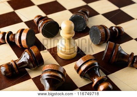 White Pawn Surrounded By Black Pawns