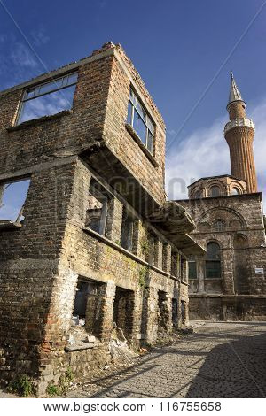 Exterior shot of an abandoned building and Molla Gurani Mosque, Istanbul, Turkey