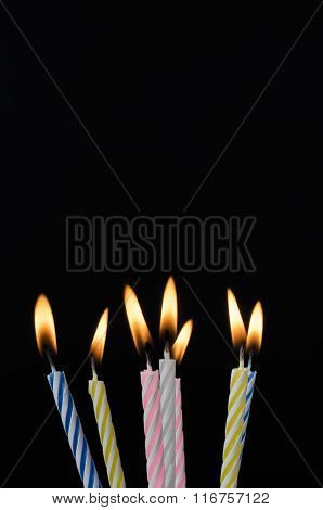 Lit Birthday Candles On Black Background