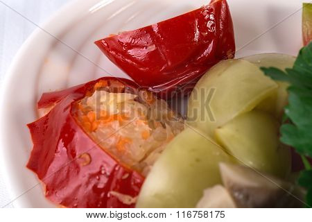 Traditional marinated green tomatoes and peppers.