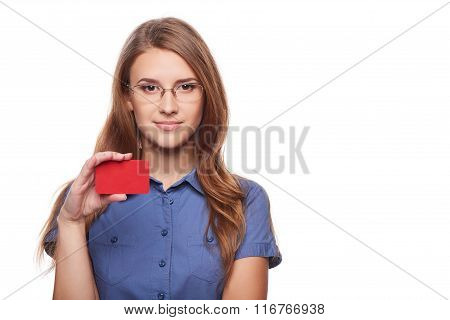 Confident business woman in glasses showing blank credit card