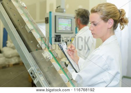 Lady auditing in factory