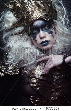Woman with black make up and white wig