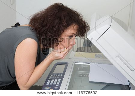 Picture Of Surprised Business Woman With Copier