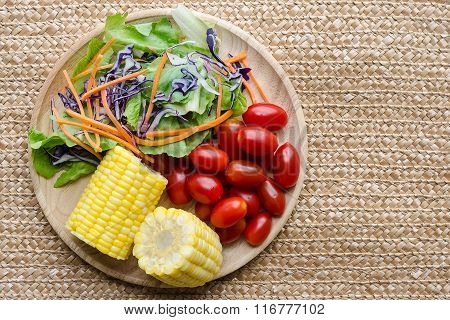 Organic Salad On Wooden Plate