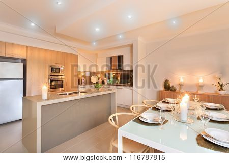 Kitchen And Dinner Table Setup With Candles Flashing Ready For The Guest Arrival