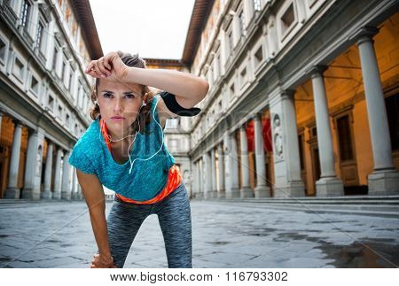 Young Fitness Female Is Catching Breathe Next To Uffizi Gallery