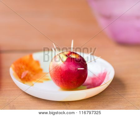 toothpicks stab into red apple