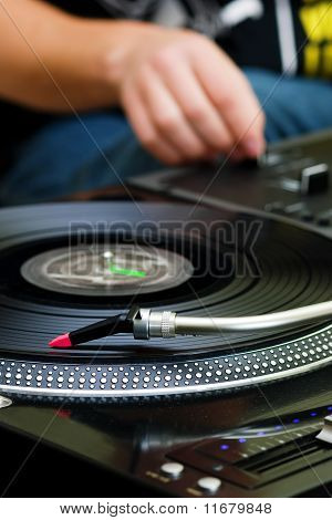 Dj Playing Music From Turntable