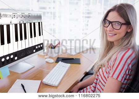 Attractive photo editor working on computer against music app