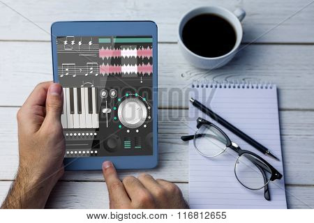 Music app against cropped image of person using tablet computer
