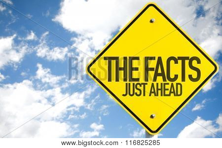 The Facts Just Ahead sign with sky background