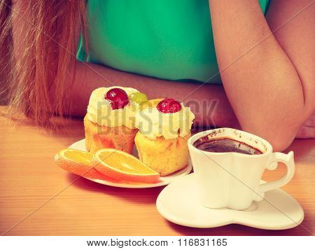Woman With Coffee Cup Cupcake In Kitchen