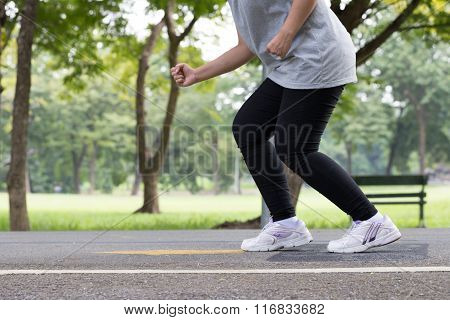 Legs And Feet Woman Jogging In The Park
