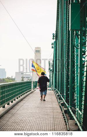 One Man Walk On Walking Way Beside Memorial Bridge