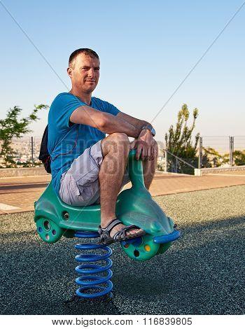 Adult man reliving childhood