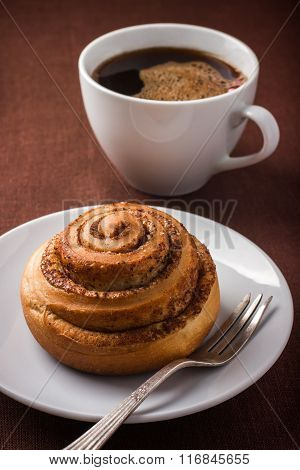 Cinnamon Roll Bun  And Cuf Of Coffee