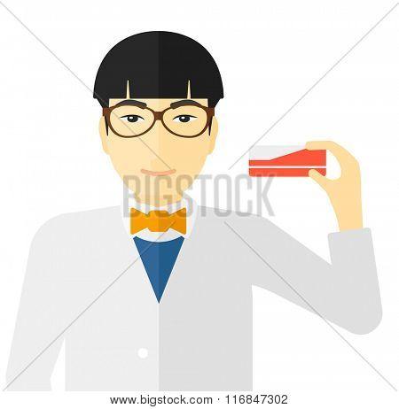 Pharmacist showing some medecine.