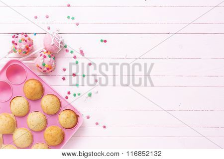 Making Cake Pops On Light Pink  Wooden Background.