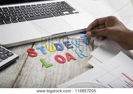 Hand Arrange Wood Letters As Student Loan Word