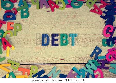 Debt Word Block Concept Photo On Plank Wood