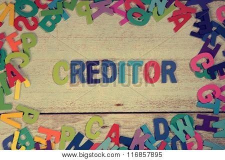 Creditor Word Block Concept Photo On Plank Wood
