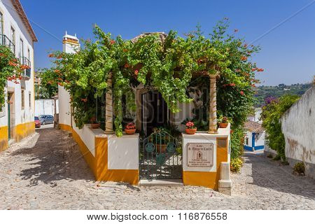 Obidos, Portugal - August, 2015: Sao Thiago Manor Guest House. Obidos is a medieval town still inside castle walls, and very popular among tourists.