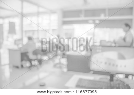 Businessmen blur in the workplace.Table Top And Blur Office of Background.abstract blur background table work in office with computer.Abstract background of office, shallow depth of focus. poster
