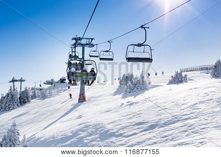 Ski resort Kopaonik, Serbia, slope, people on the ski lift, sun