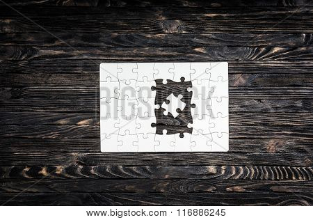 white started puzzle with uncompleted center