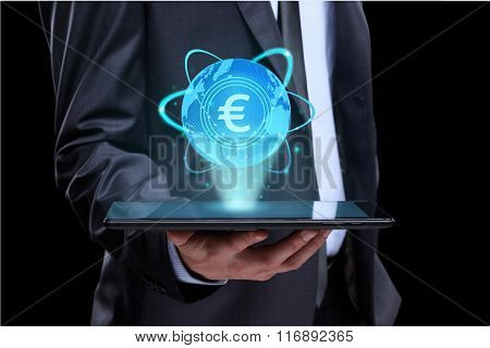 Businessman holding tablet with a projected on-screen icon online trading Euro. business Internet co