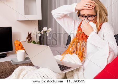 Sick woman using computer