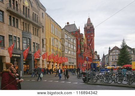 BASEL SWITZERLAND - JANUARY 1 2014: Street view of Town Hall on the Marktplatz in Basel. Basel is a third most populous city in Switzerland. It is located on the river Rhine.