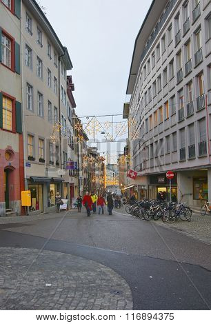 BASEL SWITZERLAND - JANUARY 1 2014: Street view with Christmas decoration in Old Town in Basel. Basel is a third most populous city in Switzerland. It is located on the river Rhine.