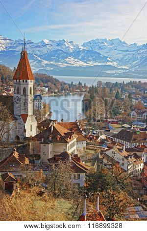 Panorama of City Church and City of Thun with Alps and Thunersee. Thun is a city in the canton of Bern in Switzerland where the Aare river flows out of Lake Thun. There is a view of Bernese Alps.