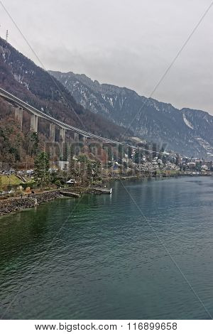 Long bridge above Montreux city center in winter. Montreux is a city in the canton of Vaud in Switzerland. It is located on Lake Geneva at the foot of the Alps.