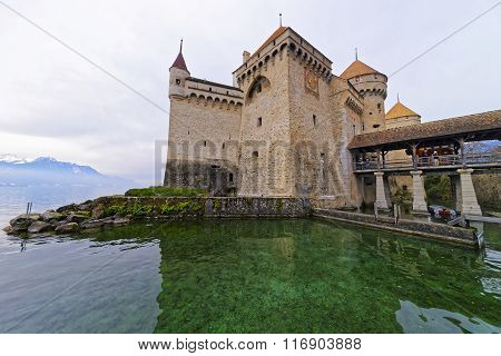 VEYTAUX SWITZERLAND - JANUARY 2 2015: Exterior of the Chillon Castle. It is an island castle on Lake Geneva (Lac Leman) in the Vaud canton between Montreux and Villeneuve. poster