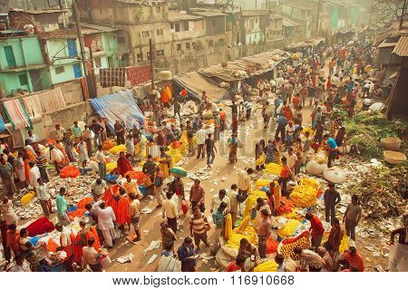 Customers And Traders Of Huge Mullik Ghat Flower Market On Old Indian Street