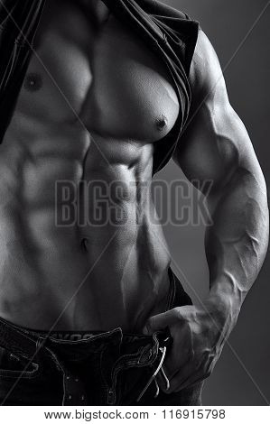 black and white image of a muscular male torso