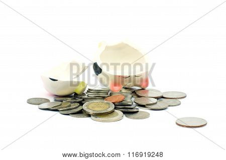 Thai Stack Coins With .broken Piggy Bank On White Background