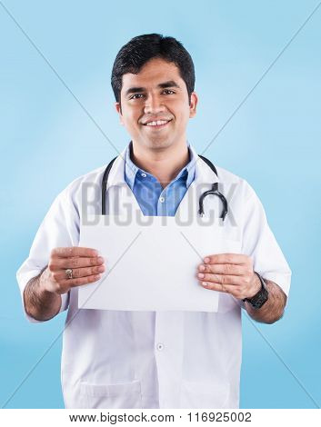 Closeup portrait of confident indian healthcare professional or doctor or nurse with stethoscope, ho