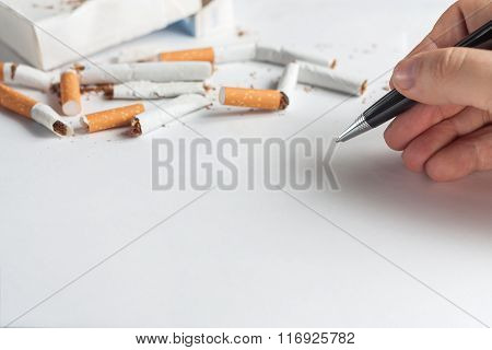 Anti-smoking background with heap of broken cigarettes