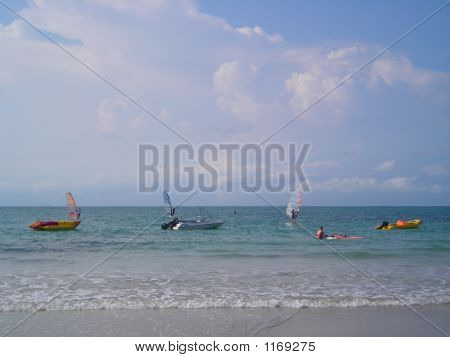 People Windsurfing At Beach