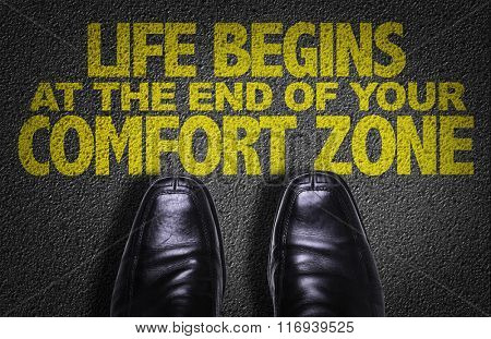 Top View of Business Shoes on the floor with the text: Life Begins At The End of Your Comfort Zone