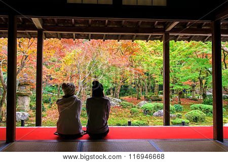 Japanese Girls Enjoy Autumn Colorful Garden At Enkoji Temple