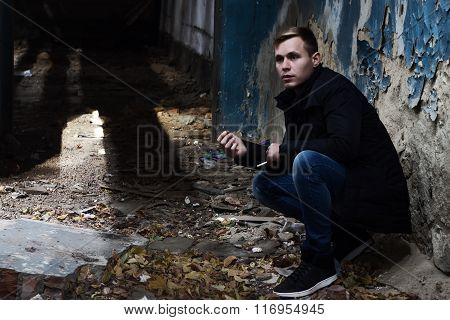 Handsome Young Man Standing In The Destroyed Building, Not Looki