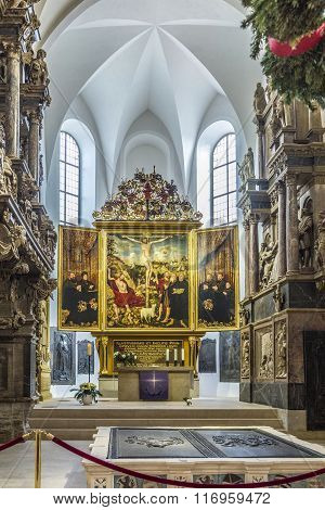 WEIMAR GERMANY - DEC 19 2015: Church St. Peter and Paul with famous altar in Weimar Thuringia Germany. The winged altar was created in 1552 by Lucas Cranach and stands for the extraordinary saxonian art in that time period. poster