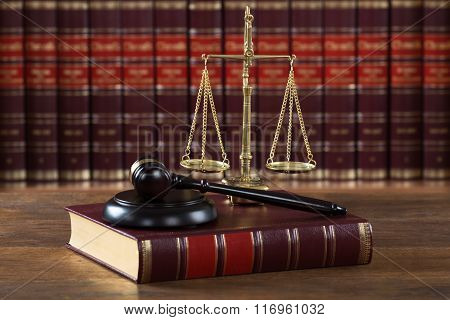 Mallet And Legal Book With Justice Scale On Table